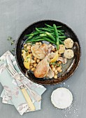 Lemon and garlic chicken with chickpeas and runner beans