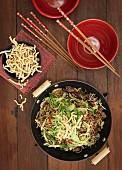 Stir-fried beef with egg noodles