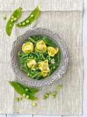 Green bean soup with spinach and tortellini