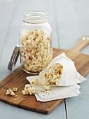 Popcorn in a paper bag and in a jar
