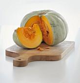 Sliced pumpkin on a chopping board