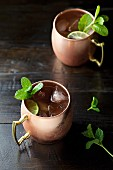 Moscow mule cocktails made with vodka, lime and mint