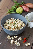 Salty popcorn with chilli and coriander