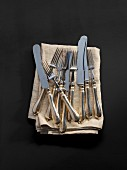 Antique cutlery on a fabric napkin