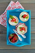 White chocolate mousse with strawberries and mint