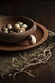 Quail's eggs in a wooden bowl