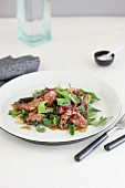 Mixed leaf salad with marinated beef and ginger