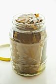 Pickled vine leaves in a screw-top jar