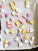 Sugar hearts on a baking tray