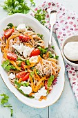 Rice noodles with sweet potato spirals, tomatoes, chard and mozzarella