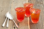 Three glasses of strawberry and lemon jelly