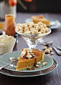 Pumpkin tart with cream, caramel sauce and popcorn