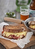 A reuben sandwich with cheese and roast beef