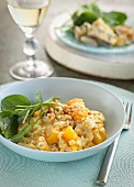 Pumpkin risotto with pine nuts and baby spinach