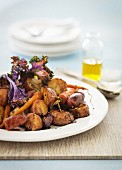 Oven-roasted vegetable salad with sausages