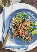 Salmon with a sesame seed crust on skewers