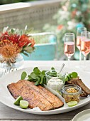 Salmon with various sauces and rye bread