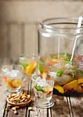 Summer sangria and roasted almonds with garlic and thyme