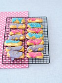 Eclairs with whipped cream, icing and dried pansy petals