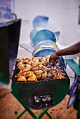 Chicken legs on a barbecue (Jamaica)