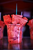 Pieces of watermelon in a plastic cup