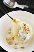 A poached pear with Gorgonzola cream, pine nuts and honey