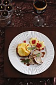 Roast pork roulade with potato gratin, apple stars and redcurrants