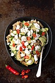 Wholemeal pasta with courgette, chilli and feta cheese