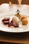 Quark dumplings, ricotta and pepper ice cream and red wine damsons in Unterwirt, South Tyrol