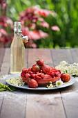 Strawberry tartlets with elderflowers