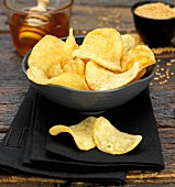 A bowl of honey-mustard crisps