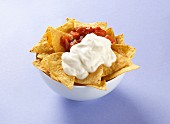 Tortilla crisps with salsa and sour cream
