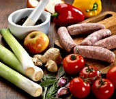 Vegetables, sausages, apples, herbs, ginger and peppercorns