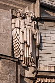 An angular figure on the Diamant House in Prague