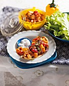 Naan bread with hake mackerel, potatoes and oven-roasted tomatoes