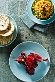 Tandoori drumsticks with fried rice and naan bread