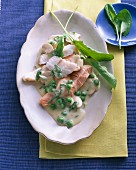 Salmon and zander with a pea sauce and herbs