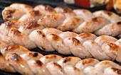 Sausage braids on a grill