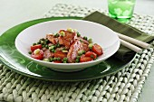 Sweet-and-sour pork loin with peas and tomatoes