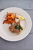 Grilled swordfish steak with grilled vegetables, lemons and pesto