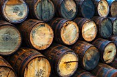 Stacks of wooden barrels at Port Askaig, Islay, Argyll and Bute, Scotland, United Kingdom, Europe