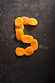 The number 5 made from dried apricots