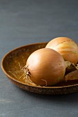 Onions on a wooden plate