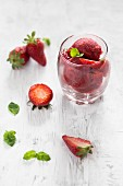Strawberry sorbet with fresh mint in a glass