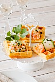Potato waffles with a spicy salmon and cucumber topping