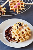 Waffles with chocolate balls and raspberry sweets