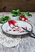 Radishes, partially sliced, on a plate