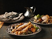 Crispy roast pork with roasted apples and caper fruits