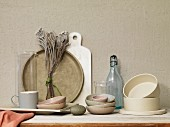 An arrangement of crockery and kitchen utensils in shades of grey