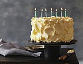 A cream cake with seven birthday candles